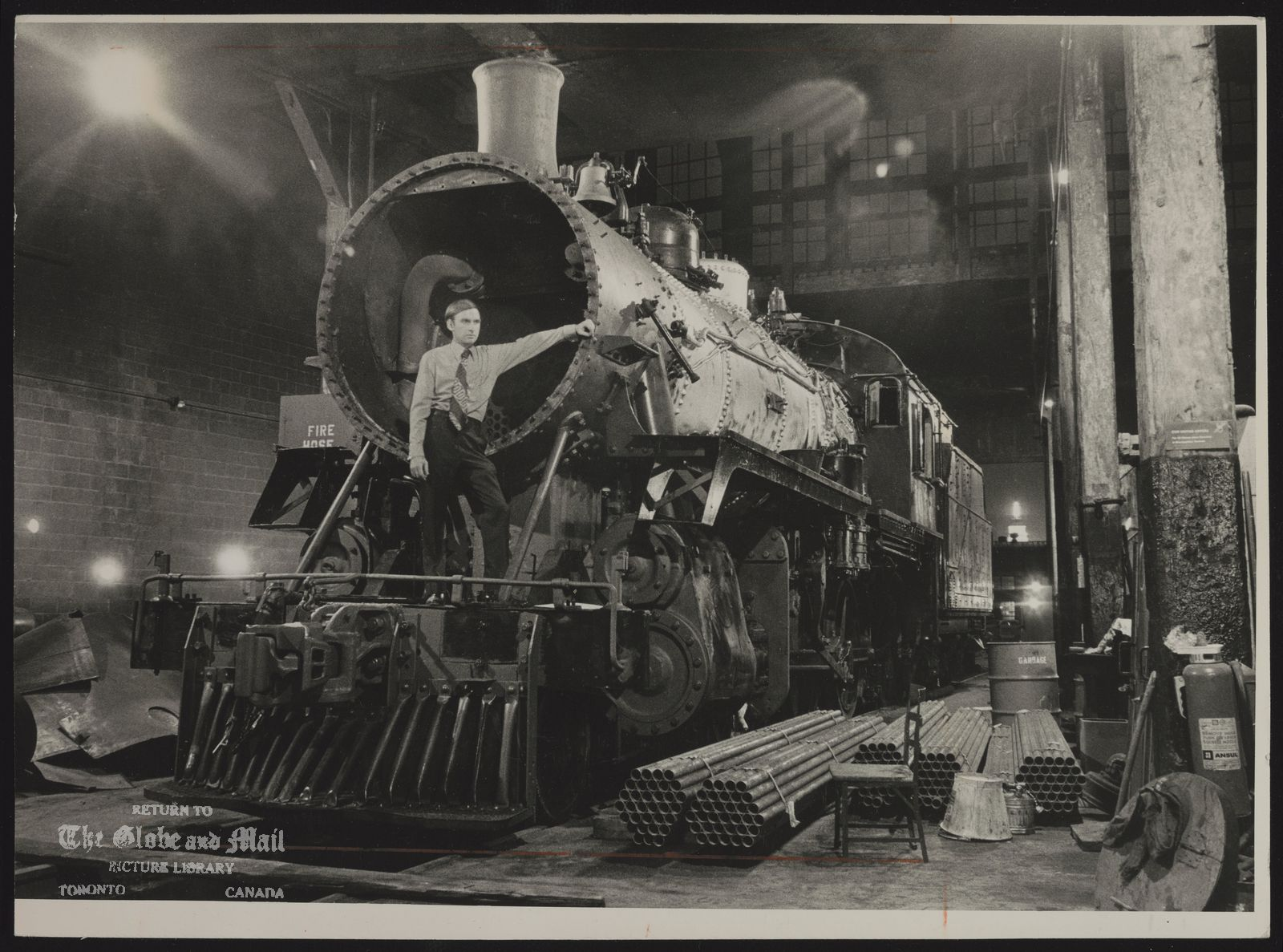 RAILWAYS Historical (Canadian Pacific locomotive No. 1057 in the roundhouse under renovation by members of the Ontario Rail Association.)