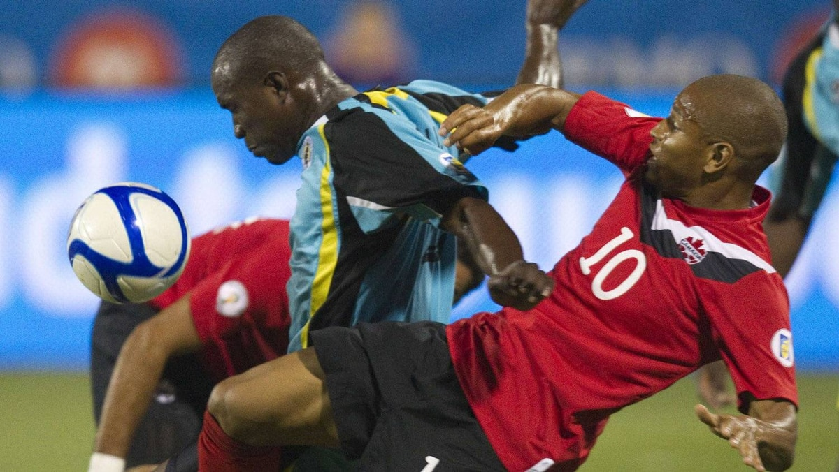 Canada's Simeon Jackson (R) and St. Lucia's Bernard Edward fight for the ball during their 2014 World Cup Qualifying soccer game in Toronto September 2, 2011. REUTERS/Fred Thornhill
