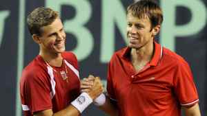 Canada's Vasek Pospisil, left, and doubles partner Daniel Nestor celebrate after defeating Ecuador in a Davis Cup doubles match in Guayaquil, Ecuador, Saturday July 9, 2011. (AP Photo/Patricio Realpe)