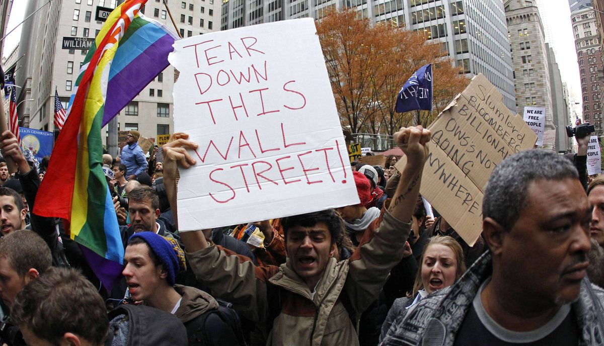 "Occupy Wall street demonstrators protest on the streets of lower Manhattan near the New York Stock Exchange during what organizers called a ""day of action"" in New York, November 17, 2011."