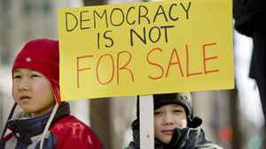 Two young children take part in a Montreal protest over the robo-call election scandal on March 11, 2012.