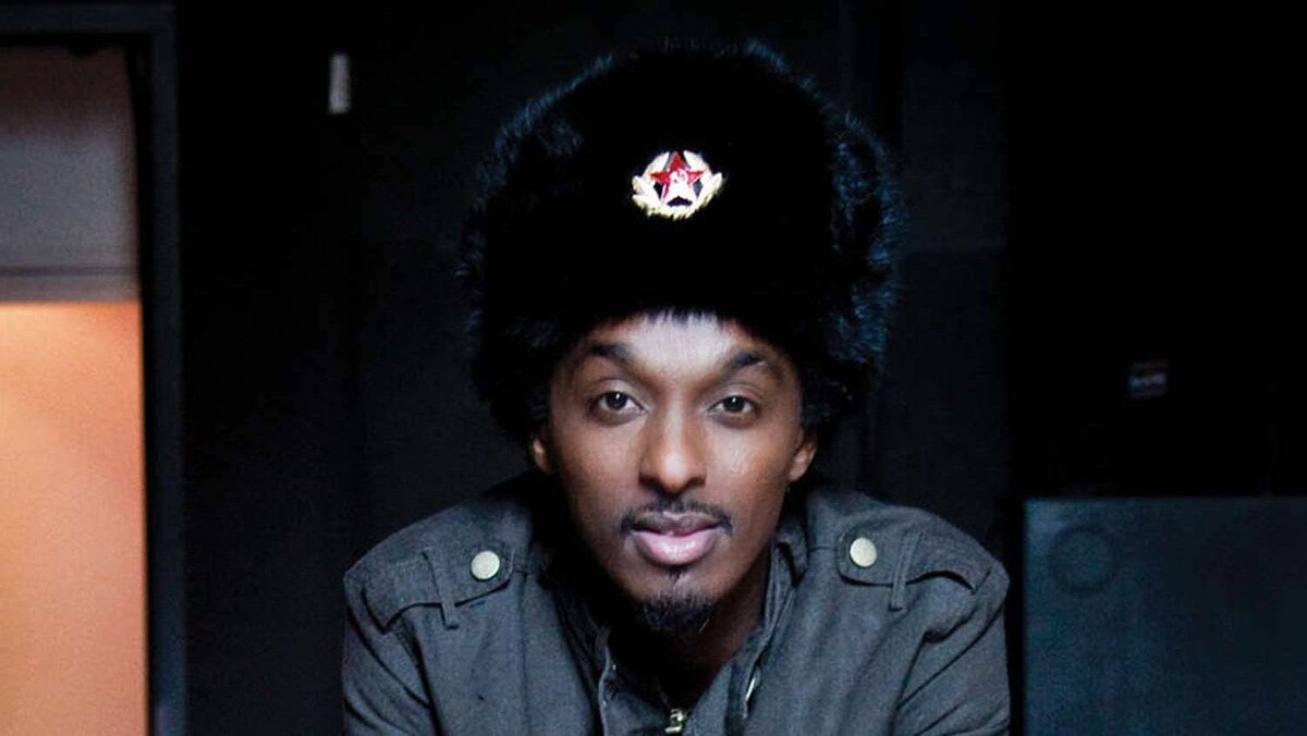 K'naan, seen here wearing a Soviet army hat, was angered that Republican primary candidate Mitt Romney used his song Wavin' Flag on his campaign.