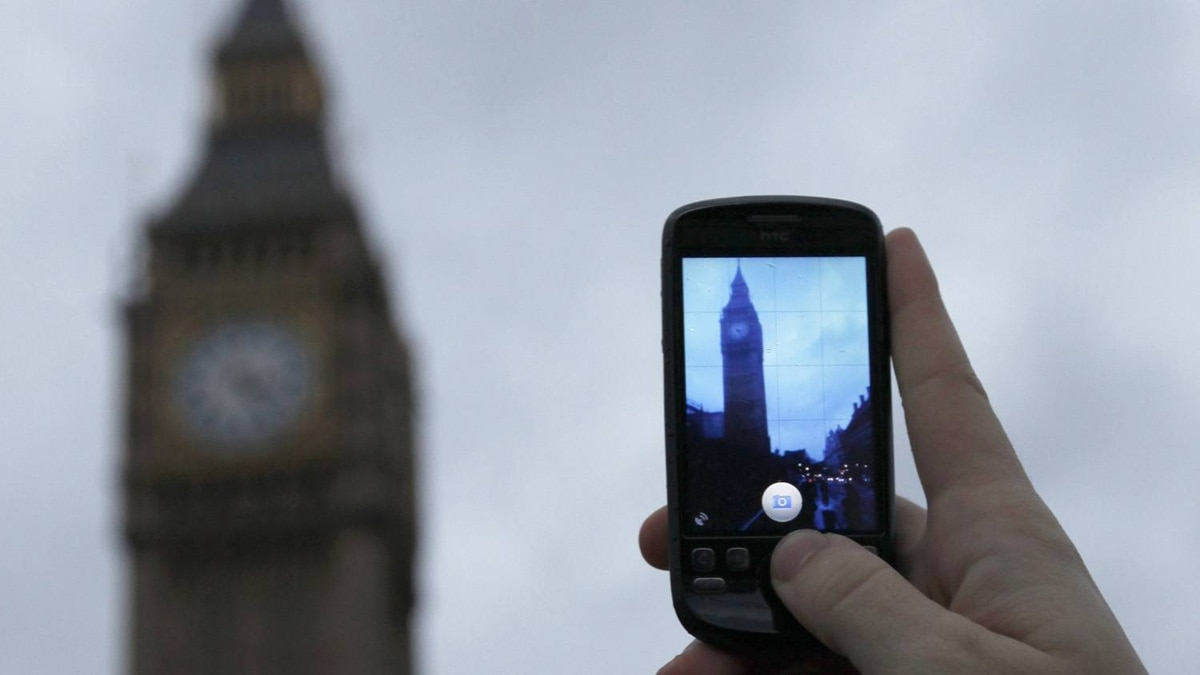 A Google employee holds up a mobile phone to demonstrate how the new Goggles application recognises Big Ben as seen from Westminster Bridge in central London. The new application recognises millions of objects and landmarks all over the world after they have been photographed on a mobile phone.