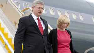 Prime Minister Stephen Harper and his wife Laureen arrive for the Commonwealth Heads of Government meeting in Perth, Australia on Oct. 27, 2011.