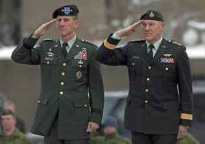 Chief of Defence Staff General Walt Natynczyk, right, and General Stanley McChrystal, the commander of U.S. forces in Afghanistan, take part in a wreath-laying ceremony at the National War Memorial in Ottawa on Tuesday December 15, 2009.