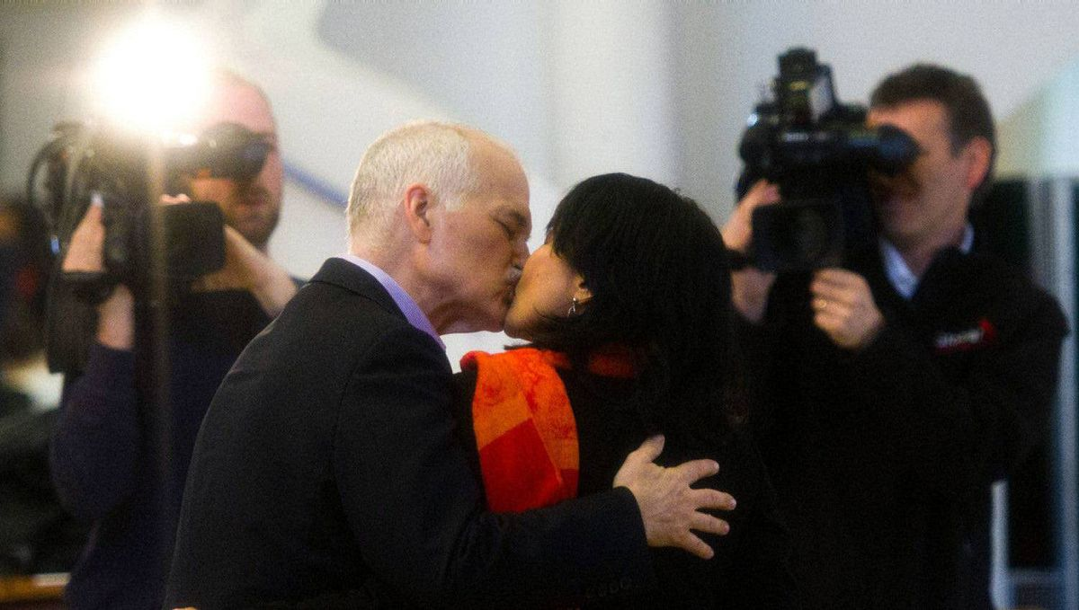 New Democratic Party leader Jack Layton, left, and wife Olivia Chow kiss after casting their ballots in Toronto, Ont., on Monday, May 2, 2011.