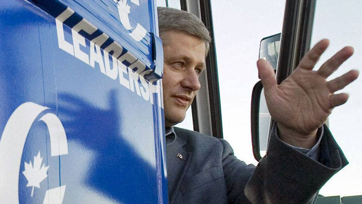 Stephen Harper waves from his campaign bus upon his arrival in Val D'Or, Que., during the 2008 election campaign.