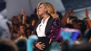 Beyonce shows her baby bump after performing Love On Top. The singer and her husband, rapper Jay-Z, are expecting their first child next spring.