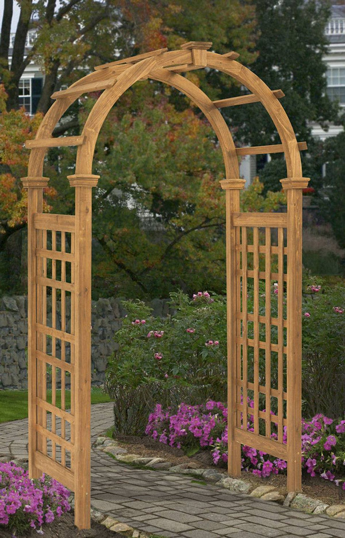 THE FLOWER CHILD Ashley's Arbors rosewood arbour, $279 at Home Depot (www.homedepot.ca).