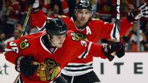 Chicago Blackhawks' Dave Bolland (36) and Patrick Sharp celebrate Bolland's goal against the Nashville Predators during the second period of Game 2 of an NHL hockey first-round playoff series Sunday, April 18, 2010, in Chicago. (AP Photo/Nam Y. Huh)