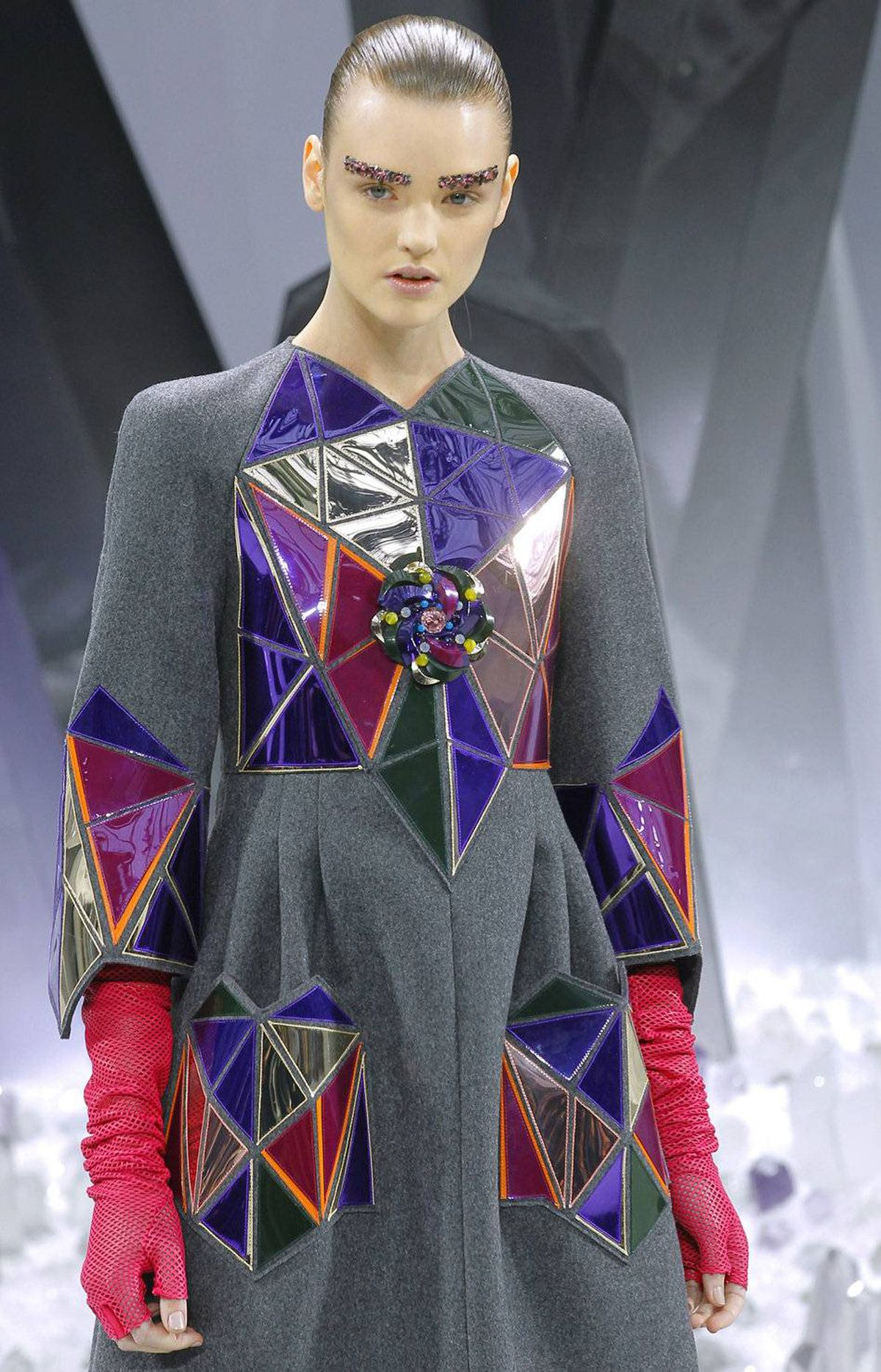 Reflective magenta and violet prism panels overshadowed the beautiful construction of this coat. At the very least, why not make them double as smartphone chargers.