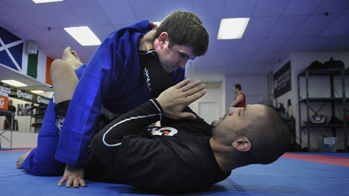 Sports reporter Darren Yourk, top. takes part in some mixed martial arts training with Firas Zahabi, at the Toronto Kickboxing and Muay Thai Academy. Zahabi trains UFC welterweight champion Georges St-Pierre.