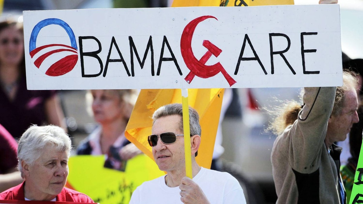A protester holds a sign outside the Portland Expo prior to a visit by U.S. President Barack Obama on April 1, 2010, in Portland, Maine. Robert F. Bukaty/AP