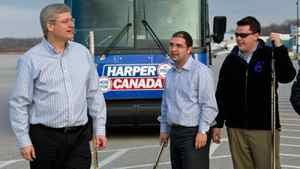 Prime Minister Stephen Harper plays ball hockey with campaign staff in Kitchener, Ont, on April 9, 2011.