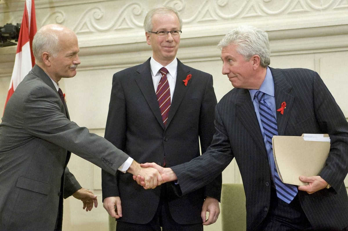 NDP Leader Jack Layton and Bloc leader Gilles Duceppe shake hands as then-Liberal leader Stephane Dion looks on after signing a coalition agreement on Dec. 1, 2008.