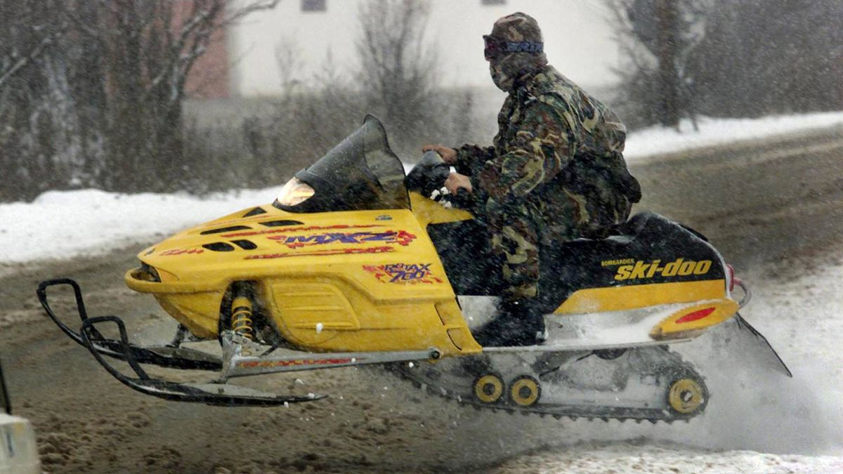 A member of the Serbian special police force patrols the village of Lucane on a Ski-Doo