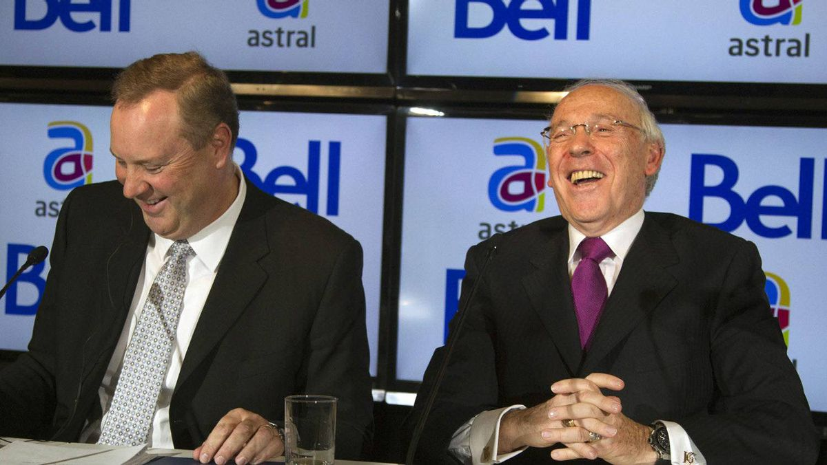 Bell Canada Enterprises (BCE) president and chief executive officer George Cope (L) and Ian Greenberg (R), president and chief executive officer of Astral Media Inc., share a laugh while speaking at a news conference in Montreal, March 16, 2012.