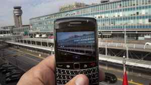 A BlackBerry user takes a picture of Pierre Elliott Trudeau Airport, Wednesday, October 12, 2011 in Montreal.