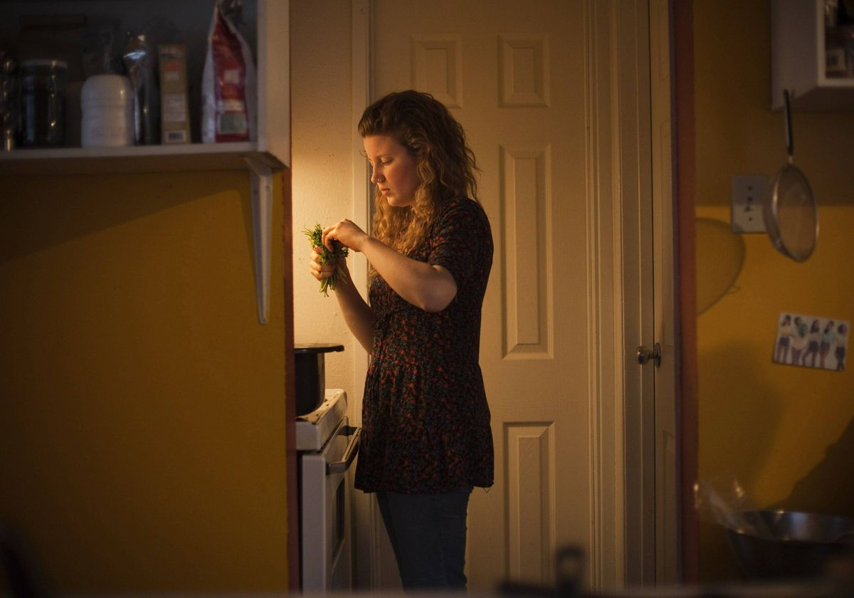 Madison Dewalt, a 'freegan', prepares food that was scavenged by the household in Vancouve.