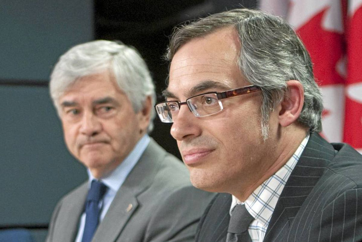 Industry Minister Tony Clement and Foreign Affairs Minister Lawrence Cannon hold a news conference in Ottawa on May 18, 2010.