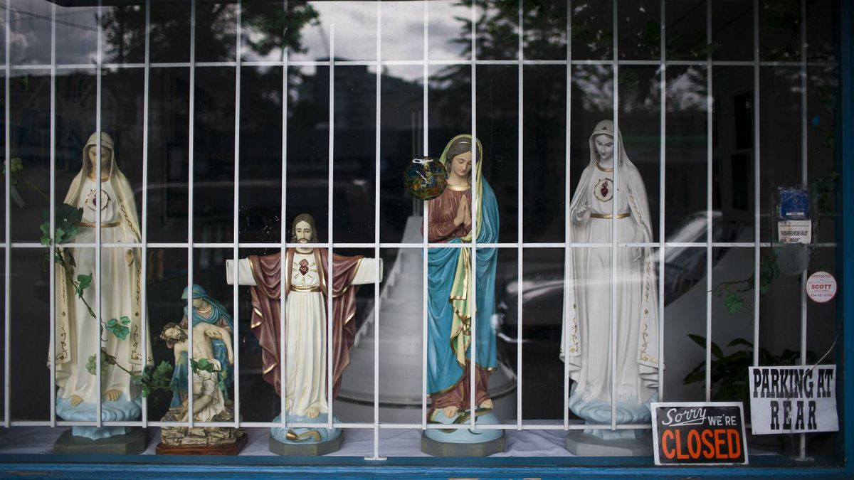 Religious items seen here in a store front window in the Mount Pleasant neighbourhood of Vancouver, British Columbia, June 30, 2011.
