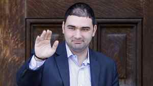 Dimitri Soudas, a spokesman in the office of Prime Minister Stephen Harper, waves as he leaves the Langevin Block in Ottawa in this June 15, 2010 file photo.
