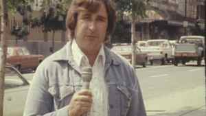 A still from film footage shot by CFCN shows Ralph Klein during his time as a reporter for the station in the 1970s.