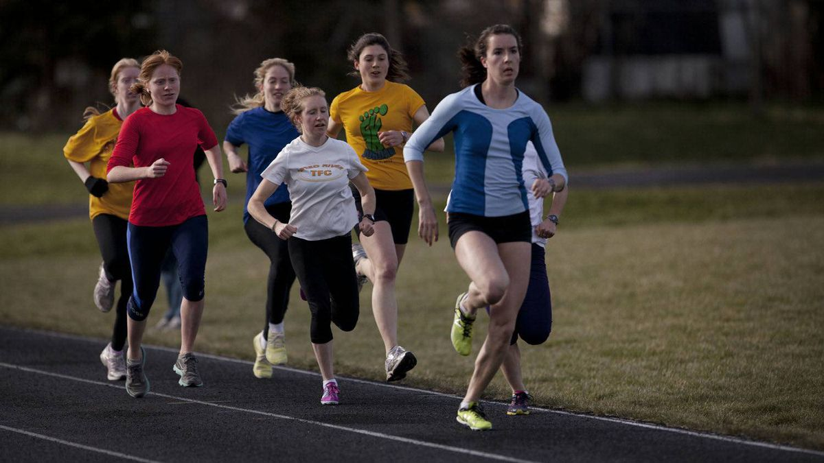 Runners in Dave Scott-Thomas's program train in Guelph on April 11, 2012.