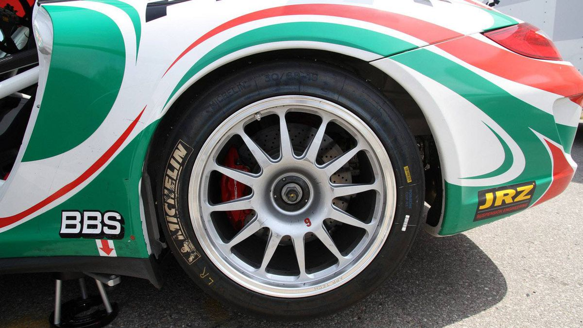 Cup cars use forged aluminum wheels with center-lock fasteners instead of wheel lugs. Note the brake duct opening in the rear fender (on far right) that allows hot air to escape from the wheel well. The brakes of a race car generate enormous heat as kinetic energy is converted to heat.