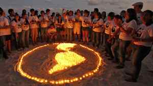 World Wildlife Fund activists light candles as they demonstrate on the sidelines of UN climate-change talks in Cancun, Mexico, on Dec. 5, 2010.