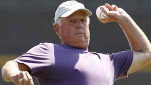 Baseball Hall of Famer Pat Gillick throws out the ceremonial first pitch in the Philadelpia Philies spring training baseball game against the Toronto Blue Jays at Florida Auto Exchange Stadium in Dunedin, Fla., Tuesday, March 22, 2011. (AP Photo/Kathy Willens)
