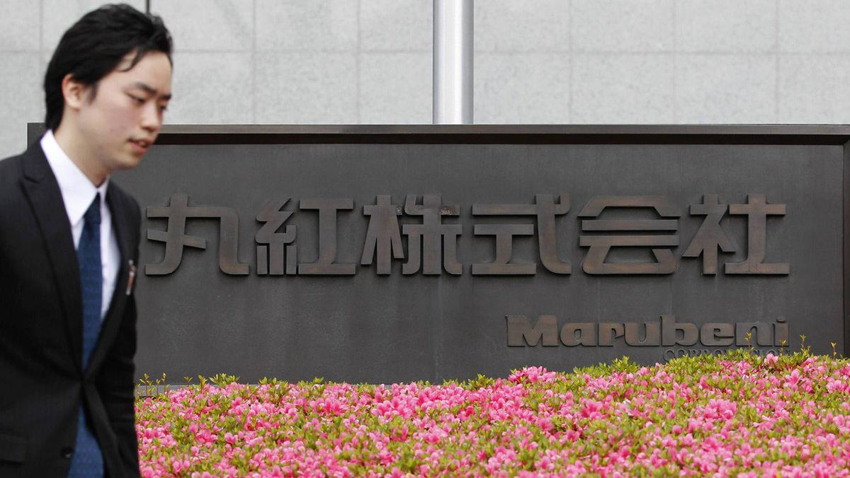 A man passes the Tokyo headquarters of Japanese trading house Marubeni Corp. on Tuesday. Marubeni is buying U.S. grains merchant Gavilon for more than $5 billion, including debt.