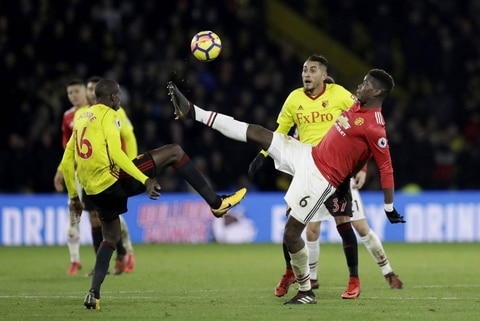 Man United beats Watford 4-2 to keep in sight of City