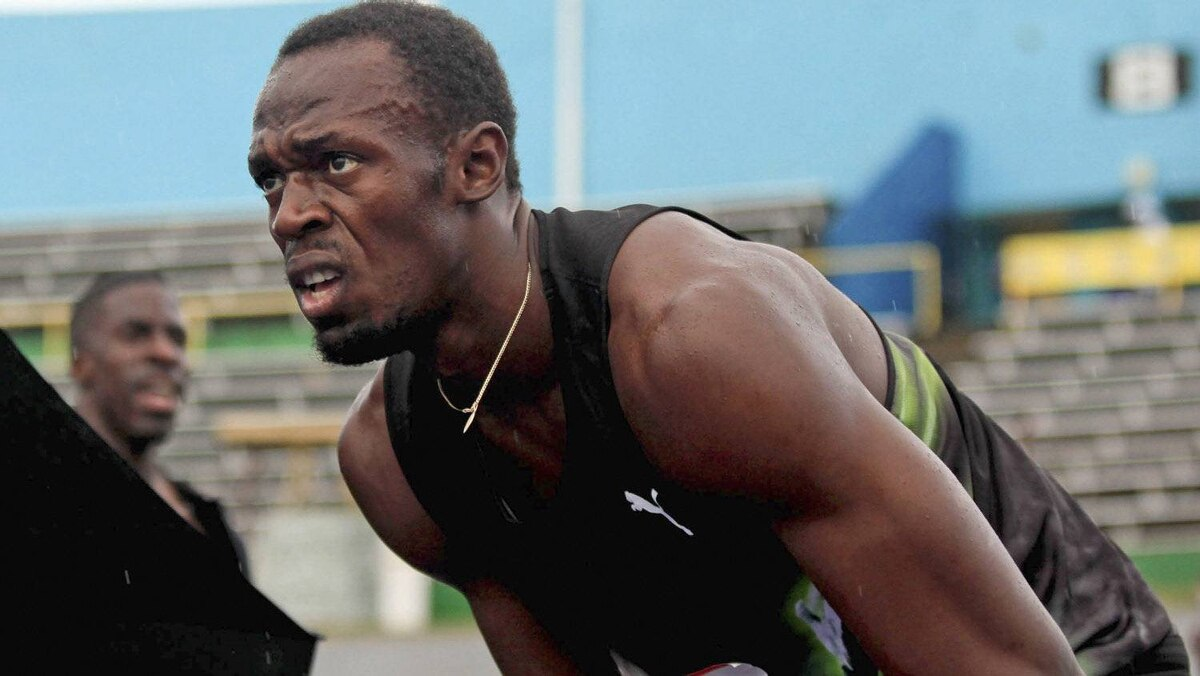 Jamaica's Usain Bolt recovers after winning the men's 4x100m relay with the Racers Track Club at the Utech Classic in Kingston April 14, 2012. Picture taken April 14, 2012. REUTERS/Gilbert Bellamy
