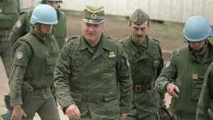 General Ratko Mladic, accompanied by an aide, and French UN security troops arrive at a UN sponsored meeting at Sarajevo's airport.