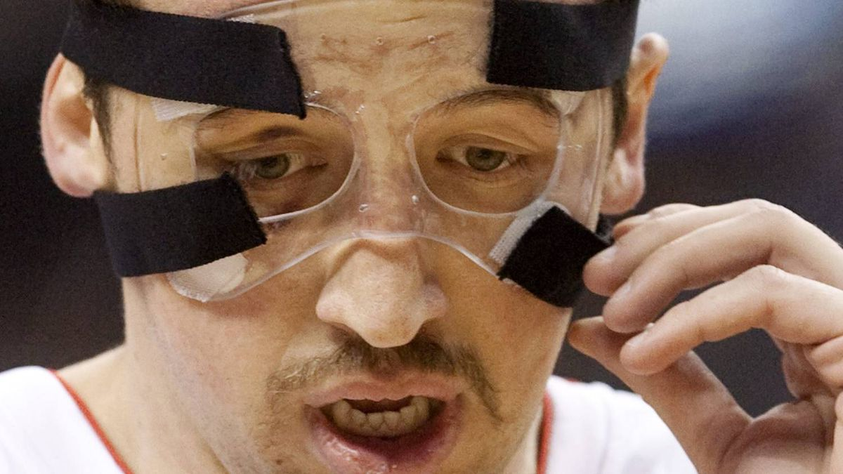 Toronto Raptors' Hedo Turkoglu, right, adjusts his protective facemask during second half NBA action against the Sacramento Kings in Toronto Sunday, February 7, 2010. THE CANADIAN PRESS/Darren Calabrese