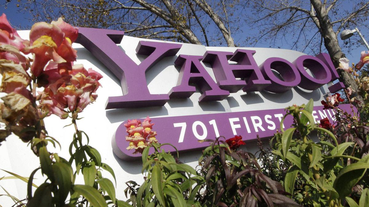 In this Jan. 4, 2012 file photo, the company logo is displayed at Yahoo headquarters in Sunnyvale, Calif. Yahoo Inc.last week announced it was laying off 2,000 employees as new CEO Scott Thompson sweeps out jobs that don't fit into his plans for turning around the beleaguered Internet company. The cuts announced Wednesday represent about 14 percent of the 14,100 workers employed by Yahoo.