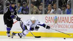 Tampa Bay Lightning centre Blair Jones, right, dives for the puck as Los Angeles Kings centre Jarret Stoll gives chase during the third period of their NHL hockey game on Thursday.