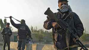 Afghan police stand guard during a clash with Taliban fighters near the Jalalabad airport on Nov. 13, 2010.