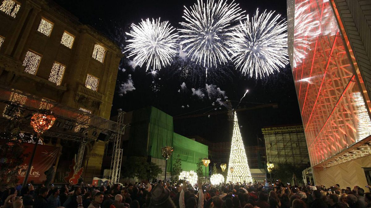 Lebanese watch a firework display the New Year's celebrations in downtown Beirut, Lebanon, Sunday, Jan. 1, 2012.