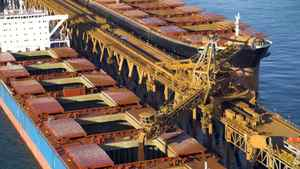 A bulk carrier is being loaded with iron ore from a Rio Tinto mine in West Australia's Pilbara region.