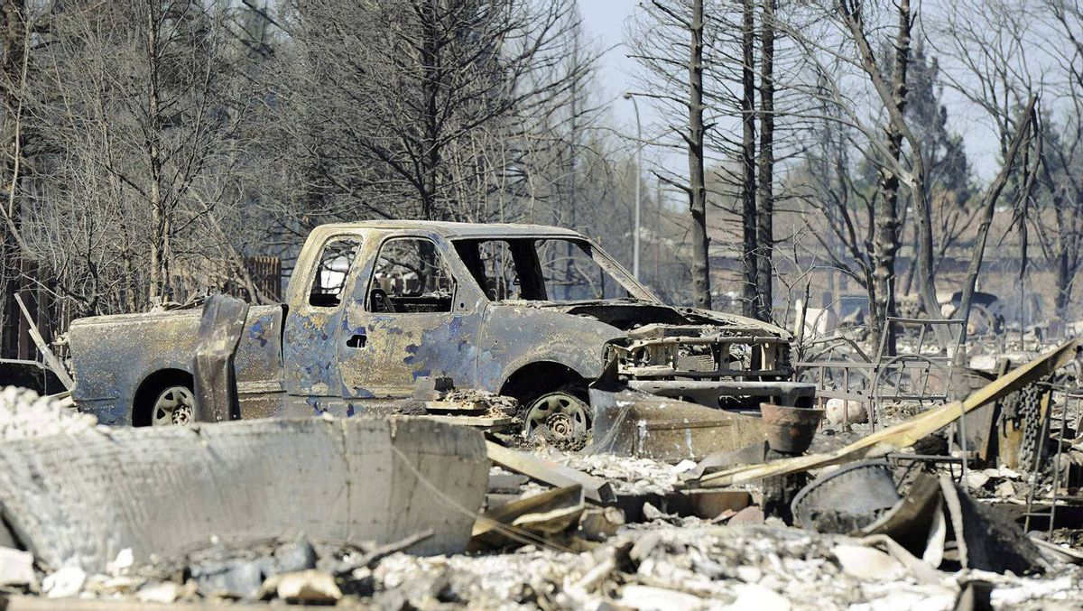 A burned-out vehicle sits in a completely destroyed neighborhood of Slave Lake, Alberta May 16, 2011.