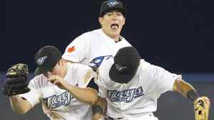 Toronto Blue Jays' newly acquired centre fielder Colby Rasmus, centre, celebrates the Blue Jays' 8-5 victory over the the Baltimore Orioles with teammates Travis Snider, left, and Eric Thames during MLB action in Toronto Thursday, July 28, 2011. for The Globe and Mail