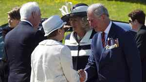 Governor-General David Johnston (L) and his wife Sharon (2nd L) greet Prince Charles (R) and Camilla, Duchess of Cornwall, during a welcoming ceremony at CFB Gagetown, New Brunswick, May 21, 2012. The Prince of Wales and his wife are on a three-day royal tour of Canada as part of events that mark the Queen's Diamond Jubilee.
