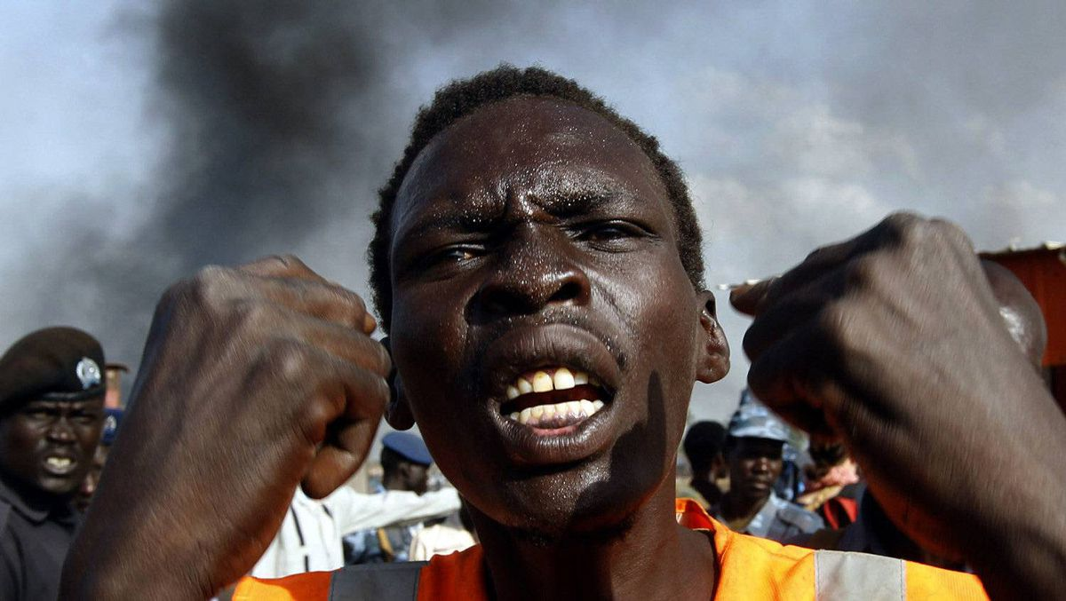 A man gestures at a market burnt in an air strike by the Sudanese air force in Rubkona near Bentiu April 23, 2012. Sudanese warplanes carried out air strikes on South Sudan on Monday, killing three people near the southern oil town of Bentiu, residents and military officials said, three days after South Sudan pulled out of a disputed oil field.