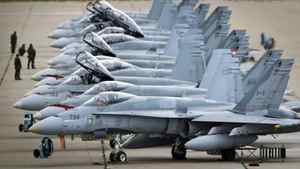 CF-18s at CFB Cold Lake, Alta., are lined up on the tarmac before take off on Sept. 18, 2010.