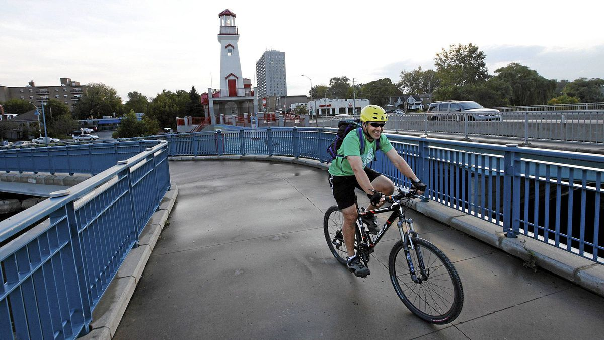 Darrin Wolter, a Citizen Member of the Mississauga Cycling Advisory Committee riding his bike in the Port Credit area of Mississauga