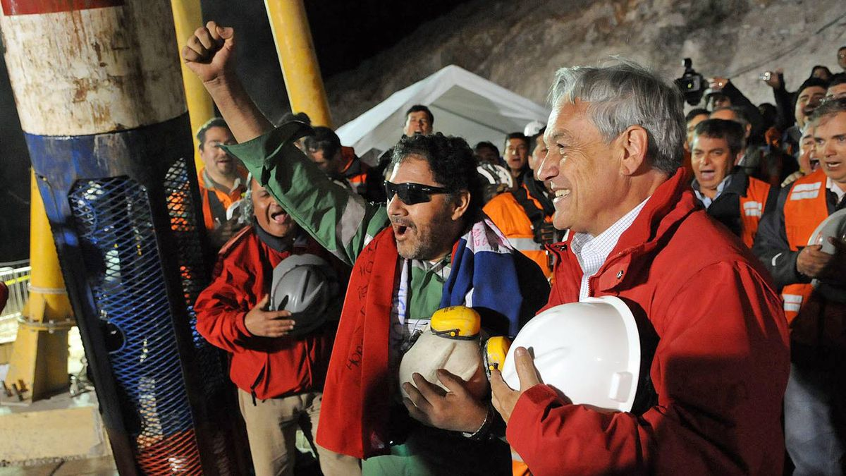 Luis Urzua, the last miner to be rescued, cheers with Chilean President Sebastian Pinera at the mouth of the San Jose mine on Oct. 13.