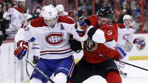 Montreal Canadiens' Erik Cole (L) collides with Ottawa Senators' Milan Michalek during the first period of their NHL hockey game in Ottawa March 16, 2012.