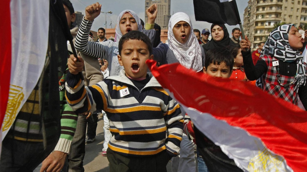 Children march in the opposition stronghold of Tahrir Square in Cairo February 8, 2011.